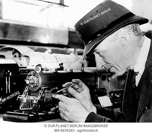 Handicraft, man repairs miniature railway, 1950s, exact place unknown, Germany
