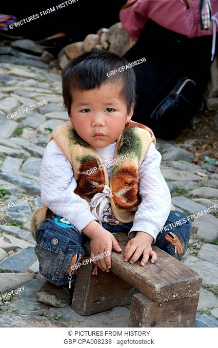 China: Young Miao boy in the village of Langde Shang, southeast of Kaili, Guizhou Province