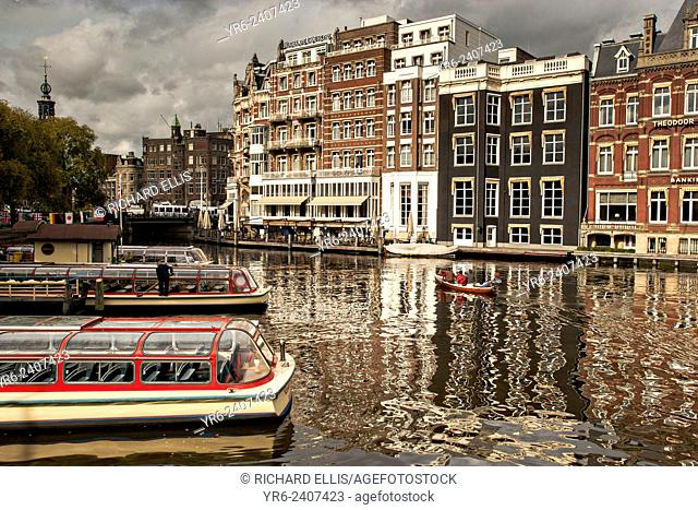 Sightseeing boats along the Amstel River in Amsterdam