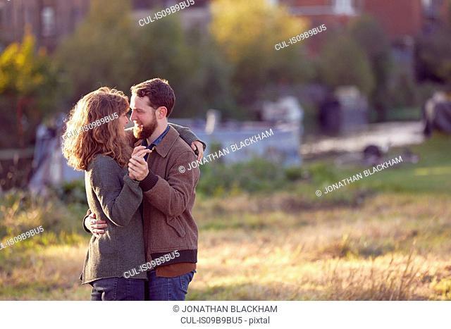 Couple slow dancing outdoors