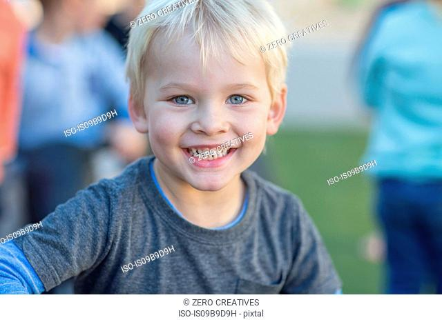 Portrait of young boy, outdoors, smiling