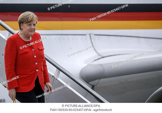 30 May 2018, Portugal, Lisbon: German Chancellor Angela Merkel alighting the plane. Merkel is in Portugal for the first time since the end of Euro crisis