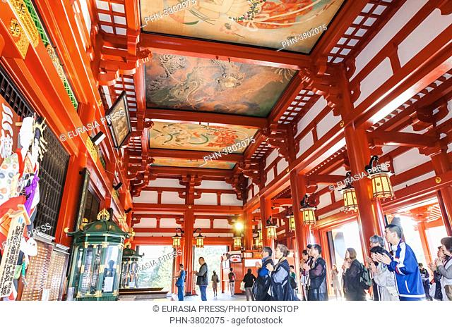 Japan, Honshu, Tokyo, Asakusa, Sensoji Temple aka Asakusa Kannon Temple, Worshippers Praying