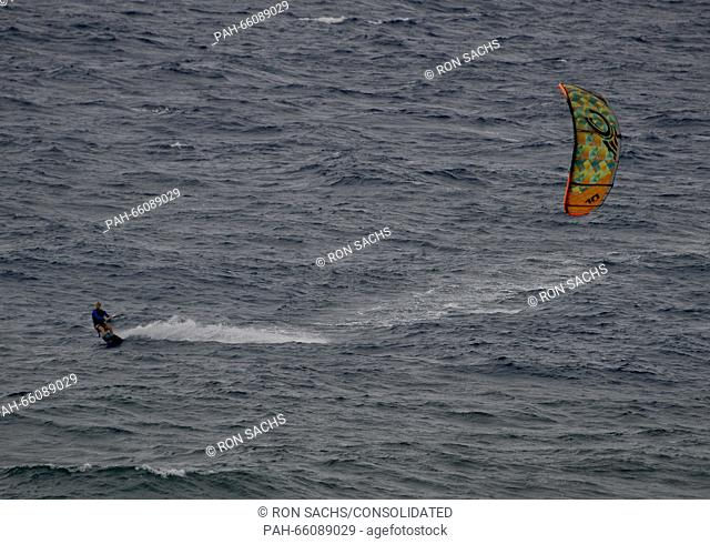 A kitesurfer in action on the water just off Kaanapali Beach, Maui, Hawaii on Sunday, February 21, 2016. Photo: Ron Sachs/CNP - NO WIRE SERVICE - | usage...
