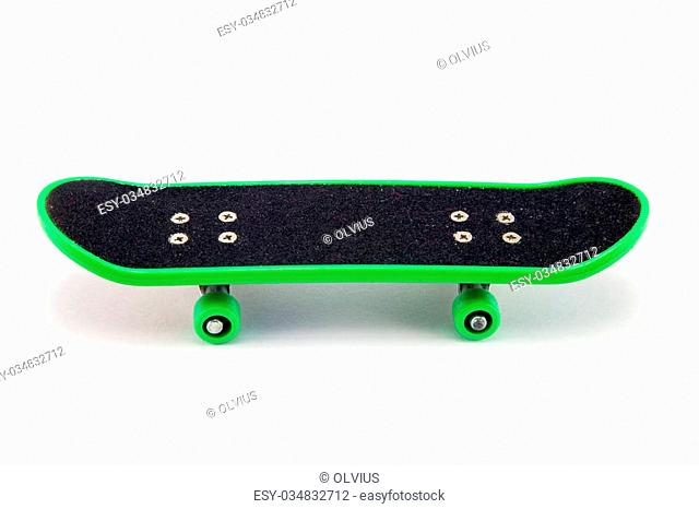 green skateboard isolated on wooden background. Stock images