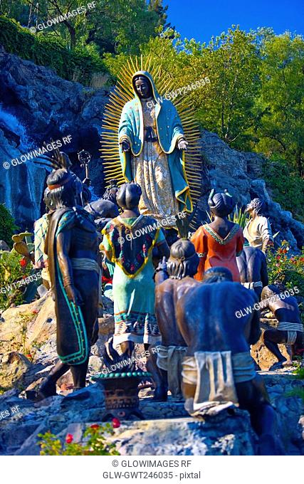 Low angle view of statues on a rock, Virgin of Guadalupe, Tepeyac, Mexico city, Mexico