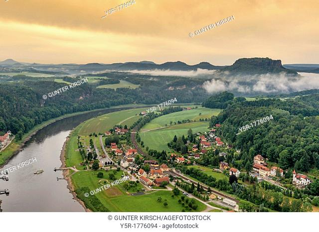 View from the spectacular rock formation Bastei Bastion in the national park Saxony Switzerland to the health resort Rathen Oberrathen and to Elbe River In the...