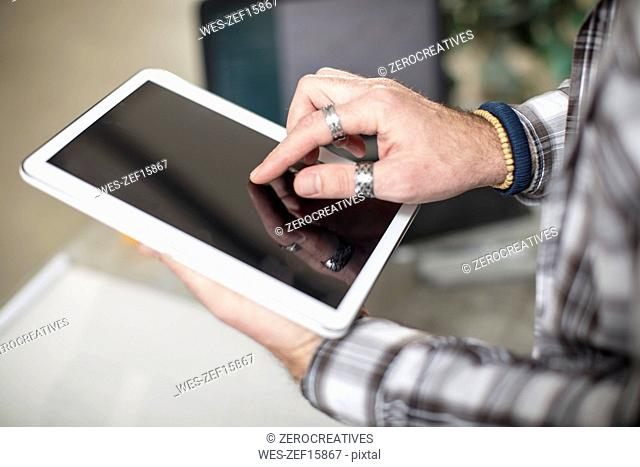 Close-up of man using tablet