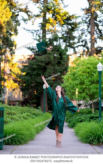 College grad student throwing hat in the air before graduation ceremonies