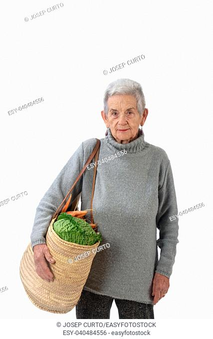 Elderly woman going shopping isolated on white,