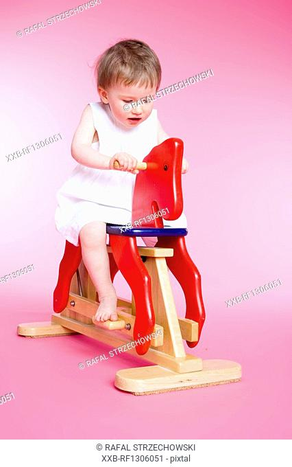 small girl riding on horse