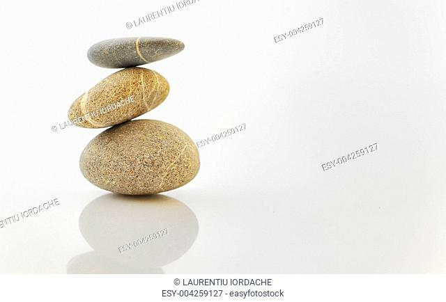 Pyramid of stones over white