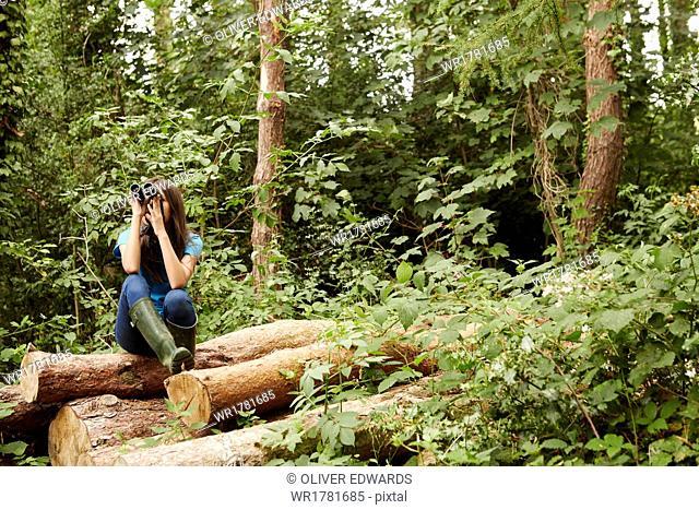 A young girl, a birdwatcher