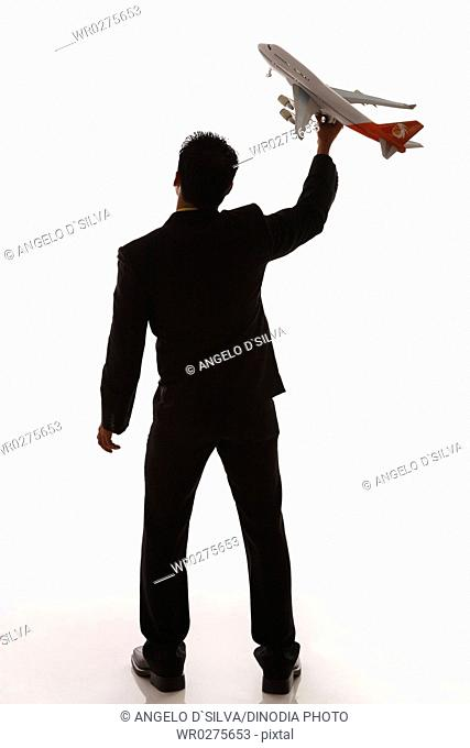 Businessman holding passenger aeroplane in flying angle MR703T,NO PR