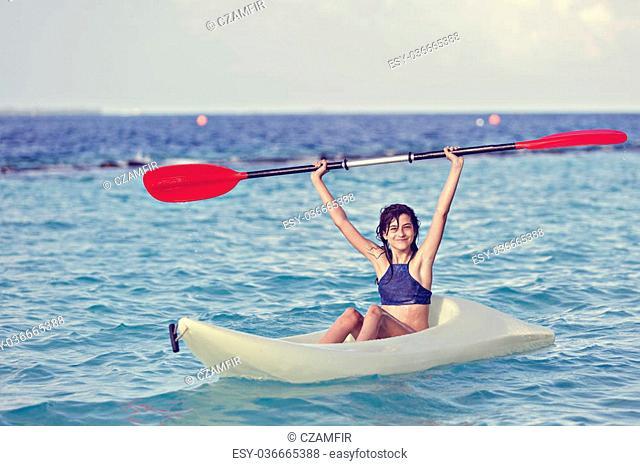 Girl on kayak in Caribbean sea