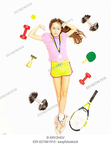Conceptual shot of girl lying on floor with set of sport equipment