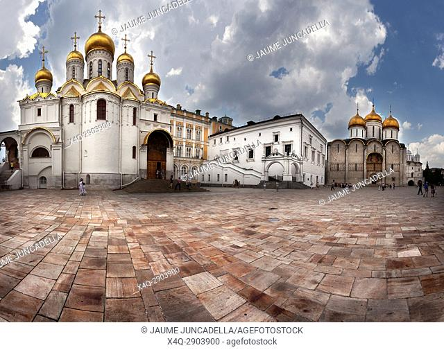 Moscow, Russia. Tourists visiting the Kremlin. Inside this Sobornaya Square where the Assumption Cathedral and the Anuncion Cathedral