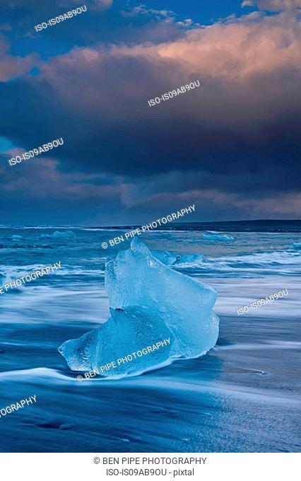 Icebergs on beach and stormy sky, Jokulsarlon, Iceland