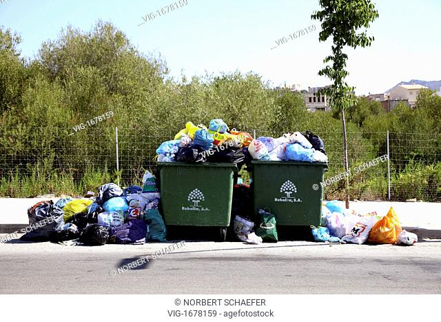 Garbage container are overfull with bin liners in Arta, Mallorca. - ARTA, MALLORCA, SPAIN, 01/01/2009