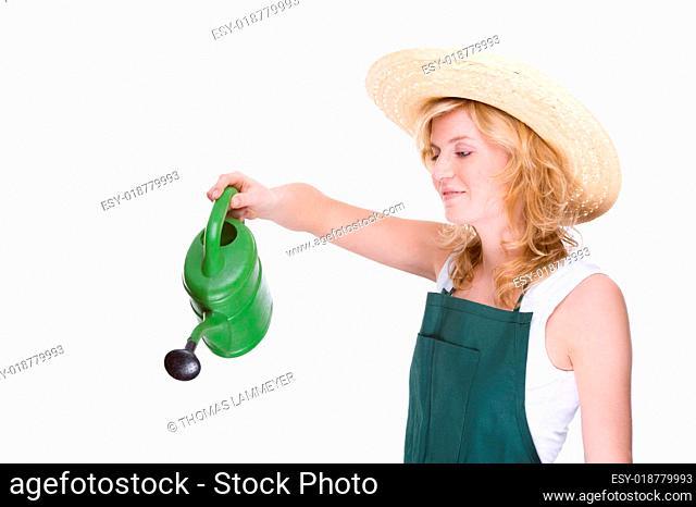 Junge Gärtnerin mit Gießkanne