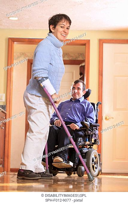 Man and woman with Cerebral Palsy in their home