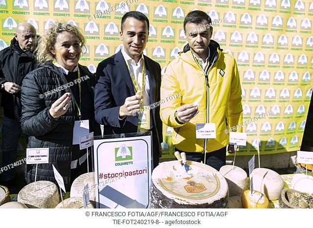Italian Deputy Premier and Labour and Industry Minister Luigi Di Maio (C) President of Coldiretti Ettore Prandini (R) attend at the event of Coldireti (National...