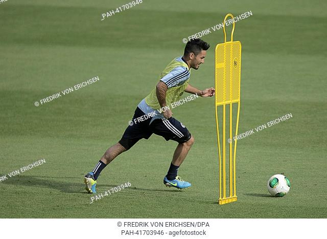 Germany's Ilkay Guendogan kicks the ball during the final training session at CofaceArena inMainz,Germany, 13 August 2013. Photo