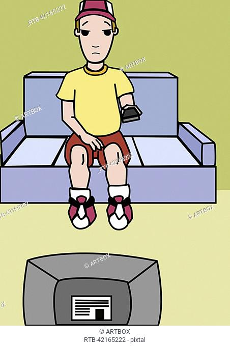 Boy sitting on a couch and watching television