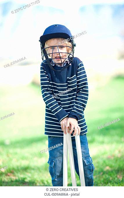 Boy in cricket helmet