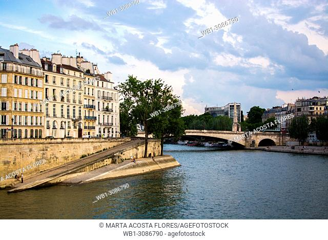 View of the Seine river and Pont de la Tournelle bridge in a sunny day. Paris, France