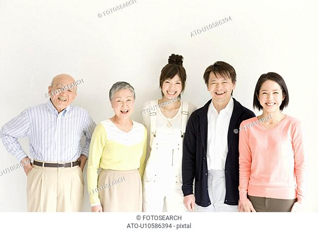 Family Portrait with Grandparents, Parents and Granddaughter, Front View, Looking at Camera