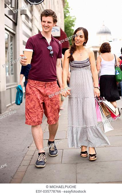 couple enjoying a day out walking round the city