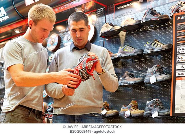 Buying protective boots. Hardware store