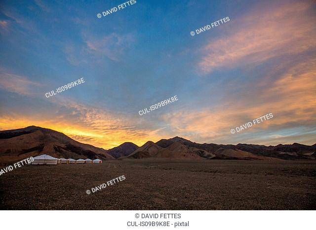 Scenic view with row of yurts in Altai Mountains at sunrise, Khovd, Mongolia