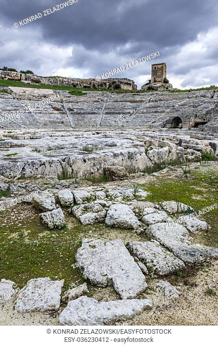 Stage and cavea of ancient ruins of Greek Theater from 5th century BC in Neapolis Archaeological Park in Syracuse city, Sicily Island, Italy