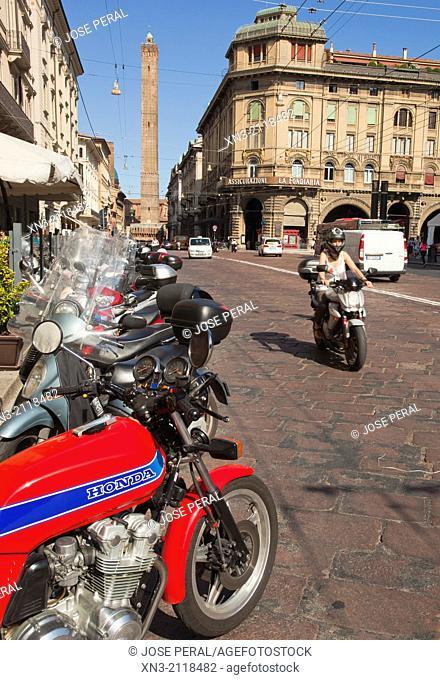 Francesco Rizzoli street on background Asinelli tower, Two Towers symbol of Bologna in Porta Ravegnana Square, Bologna, Emilia-Romagna, Italy, Europe
