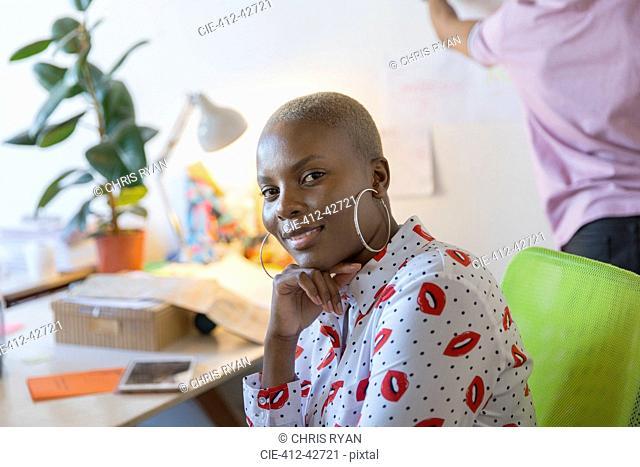 Portrait confident, ambitious businesswoman
