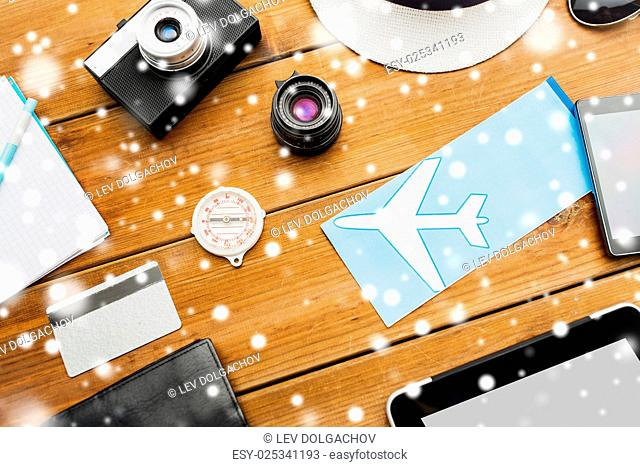 vacation, travel, tourism, winter holidays and objects concept - close up of camera and traveler personal stuff