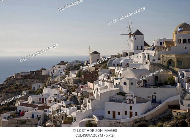 View of white washed hillside town and windmills, Oia, Santorini, Cyclades, Greece