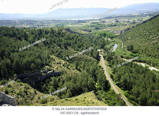 Natural landscape of the Xativa mountains, with the rails of the train and the river Albaida. Genoves, Valencia, Spain