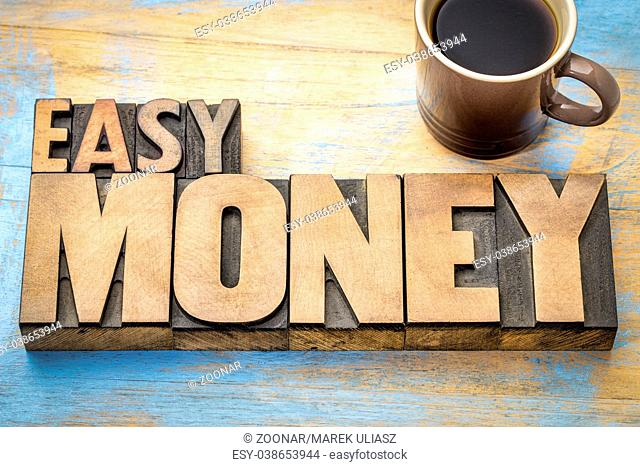 easy money word abstract in letterpress wood type
