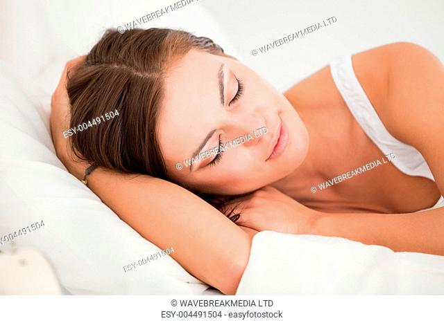 Young woman sleeping in her bed