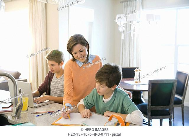 Woman assisting son with homework