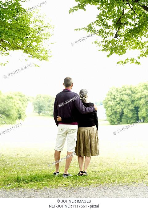 Senior couple standing in park
