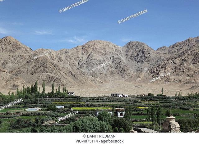 The village of Sakti surrounded by farmland deep in the mountains in Sakti, Ladakh, Jammu and Kashmir, India. - SAKTI, LADAKH, India, 04/07/2014