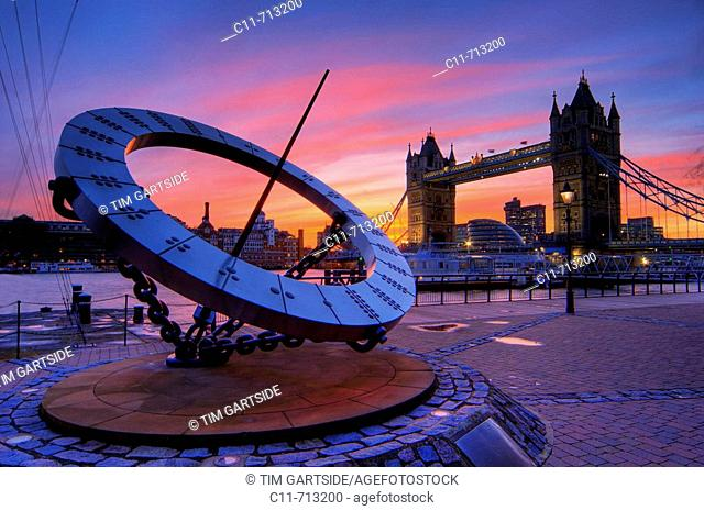 tower bridge and giant time sundial dusk sunset london england uk europe