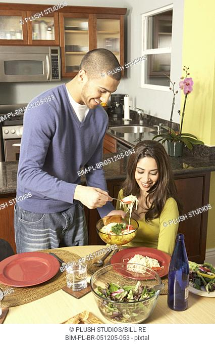 Young Hispanic couple at the dinner table, San Rafael, California, United States