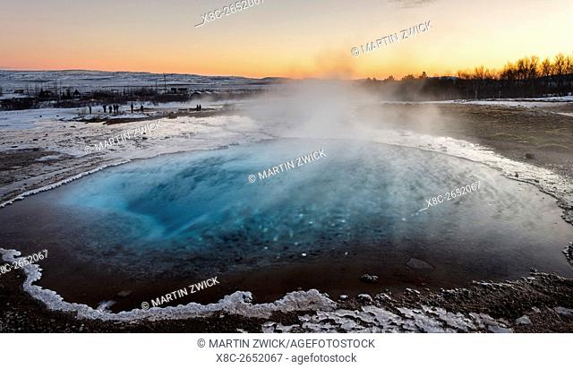 The geothermal area Haukadalur part of the touristic route Golden Circle during winter. Geysir Strokkur in the background