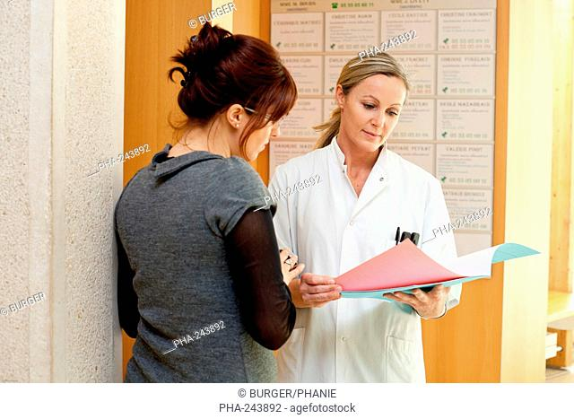 Hospital doctor talking with a patient