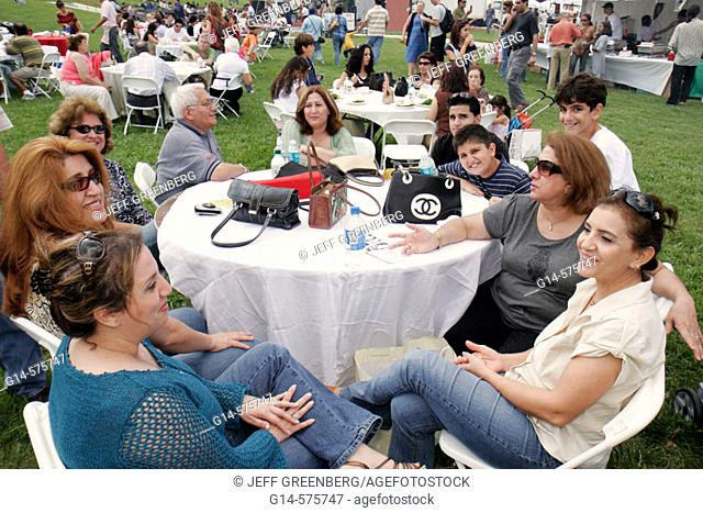 Iran, Persian, family, talking, women, boys. Iranian Festival. Bayfront Park. Miami. Florida. USA